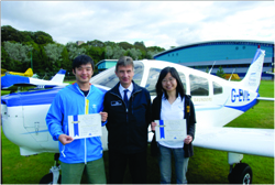The Hong Kong flying students pictured with their Tayside trainer