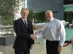Lee Woodward from CTC and Mike Kitney of Dragonair sign the partnership contract