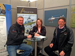 Signing the order at Heli UK Expo. From left: Andy Moorhouse, Cotswold Helicopter Centre, Sarah Bowen, Helicentre Aviation, Oliver Heynes, Cotswold Helicopter Centre