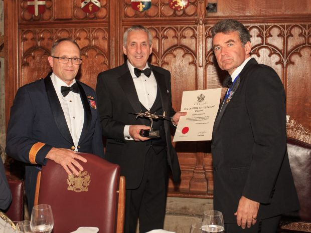 Jim Watt, Managing Director Tayside Aviation (centre) receiving The Royal Air Force Central Flying School Trophy